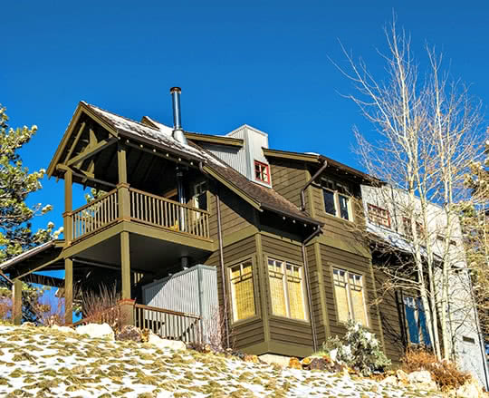 Architectural home painted high above Helena MT